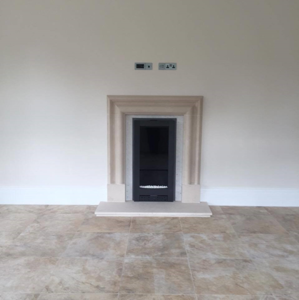 Riva electric fire fitted Into customers own surround